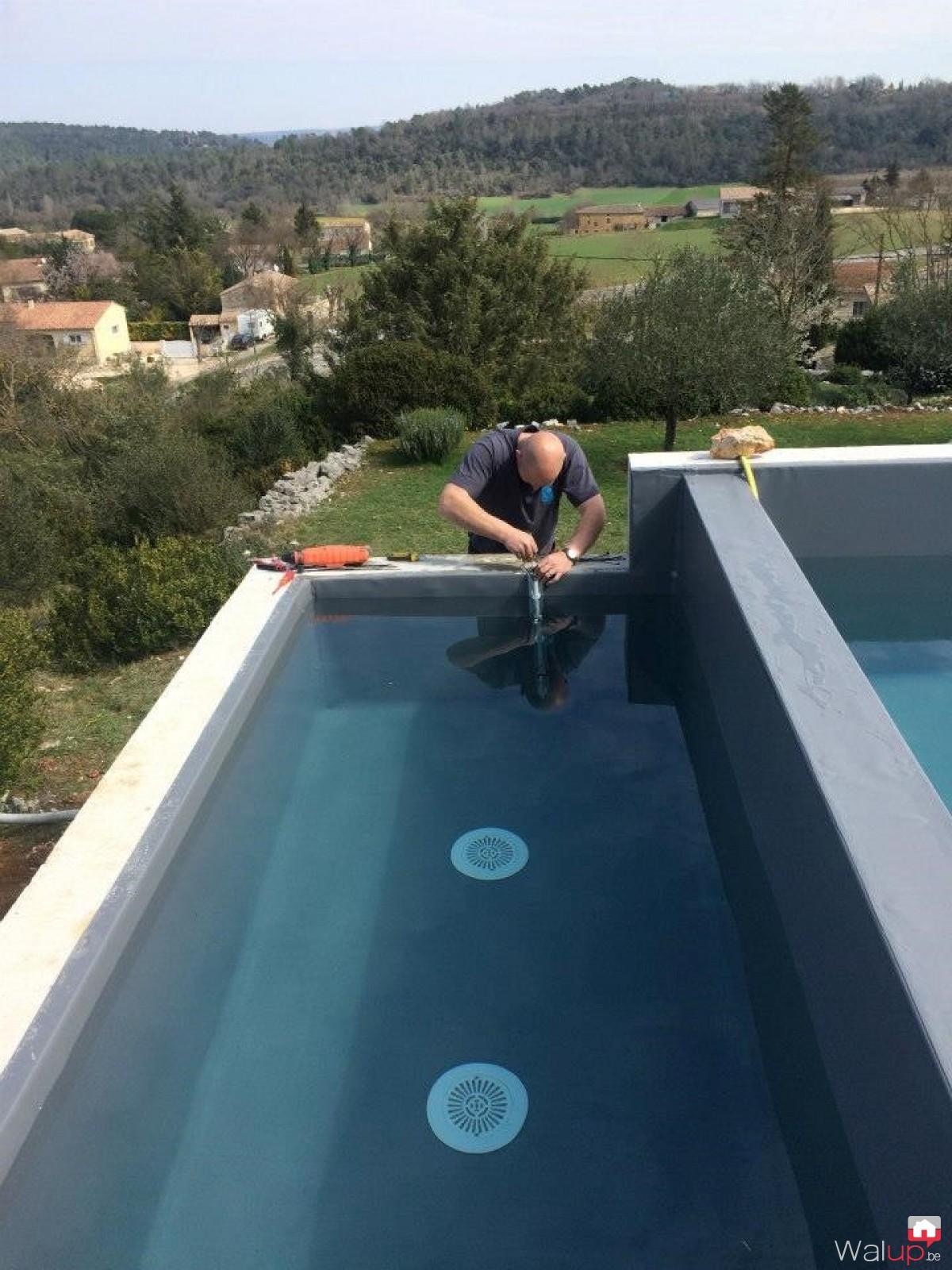 Piscine d bordement par pool conception sprl for Conception piscine