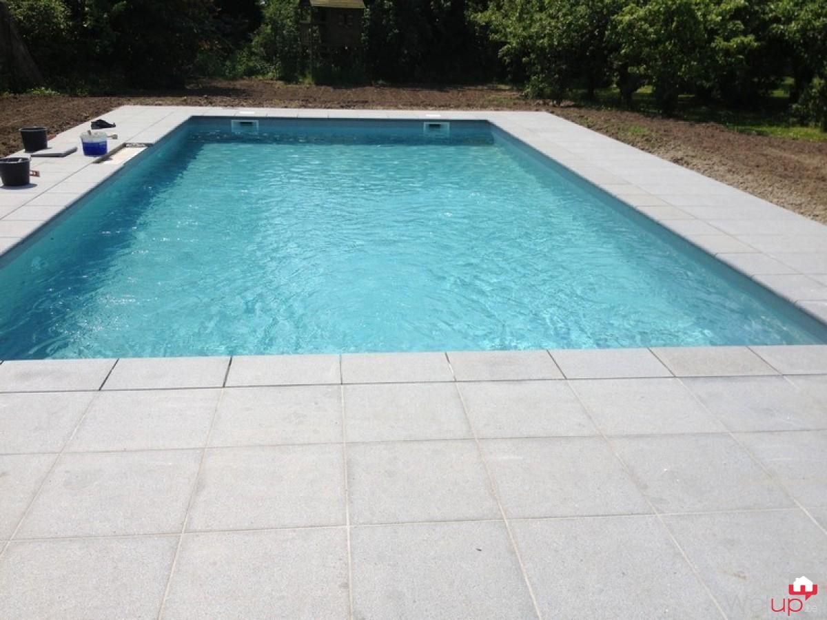 Construction d 39 une piscine ext rieure par pool for Conception piscine