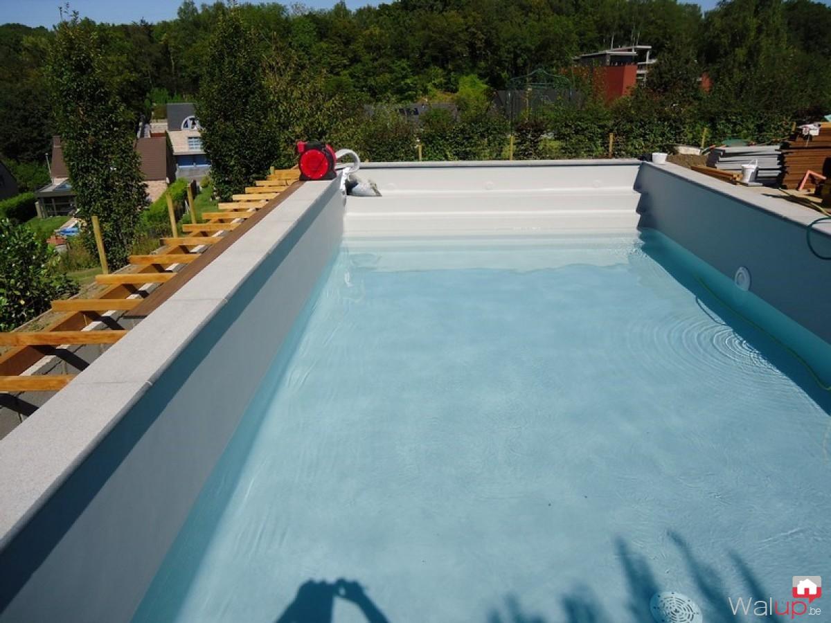 Construction d 39 une piscine namur par pool conception sprl for Accessoire piscine namur